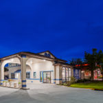 Night time exterior of SureStay Hotel by Best Western Jacksonville South